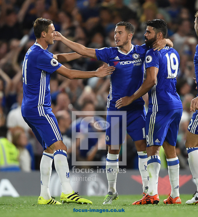 Chelsea's Eden Hazard celebrates scoring their first goal from the penalty spot with team mates during the Premier League match at Stamford Bridge, London<br /> Picture by Daniel Hambury/Focus Images Ltd +44 7813 022858<br /> 15/08/2016