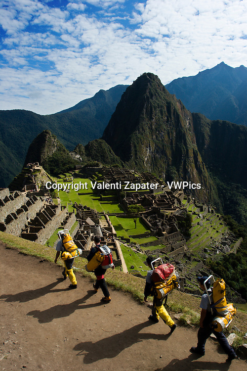 Members of Ukhpacha Project entering the popular Machu Picchu citadelle