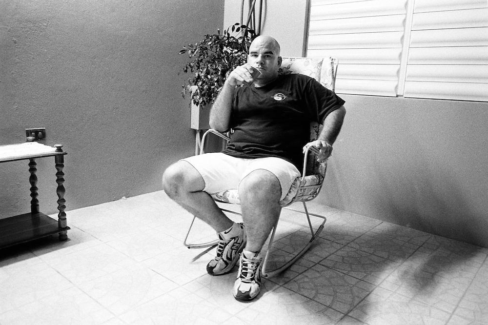 Carmelo Rosado, in his porch in Aguadilla Puerto Rico.