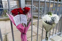 April 13, 2018 - London, London, UK - London, UK. Flowers and messages outside Galleon House, Manchester Road on the Isle of Dogs in Tower Hamlets. A man in his 30's was found injured from a stab wound yesterday morning and died at the scene. A woman, Alex Glanfield-Collis, of Manchester Road has been charged with murder, to appear at Thames Magistrates Court this morning. (Credit Image: © Vickie Flores/London News Pictures via ZUMA Wire)