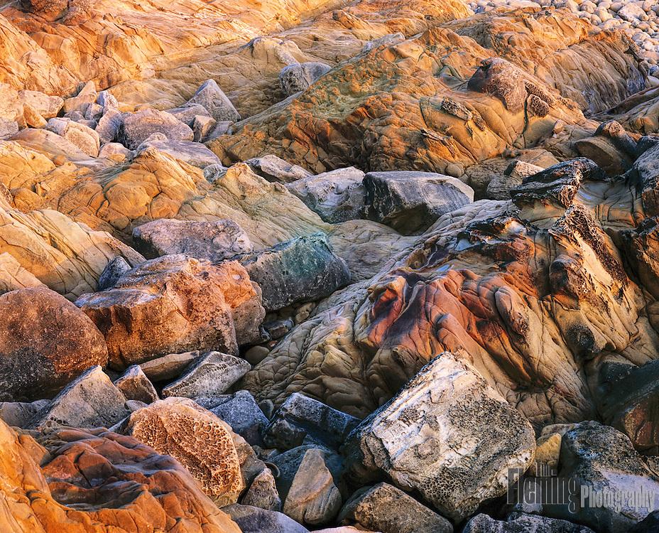 Boulders on shoreline at dusk