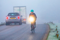 © Licensed to London News Pictures. 06/02/2020. London, UK. Cyclists and car drivers commute in dense fog in Richmond Park this morning as weather experts predict high winds and heavy rain for the weekend. Photo credit: Alex Lentati/LNP