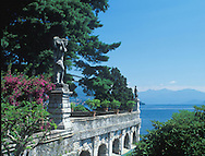 Stone statue in the Isola Bella Garden overlooking<br /> Lake Maggiore, Lombardy, Italy