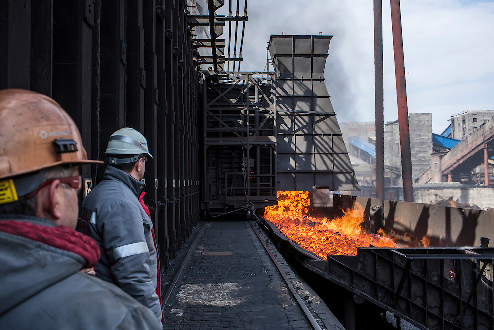 AVDIIVKA, UKRAINE - MARCH 18, 2015: Workers at the Avdiivka Coke and Steel plant watch as hot coke is transfered out of the furnaces in Avdiivka, Ukraine. CREDIT: Brendan Hoffman for The New York Times