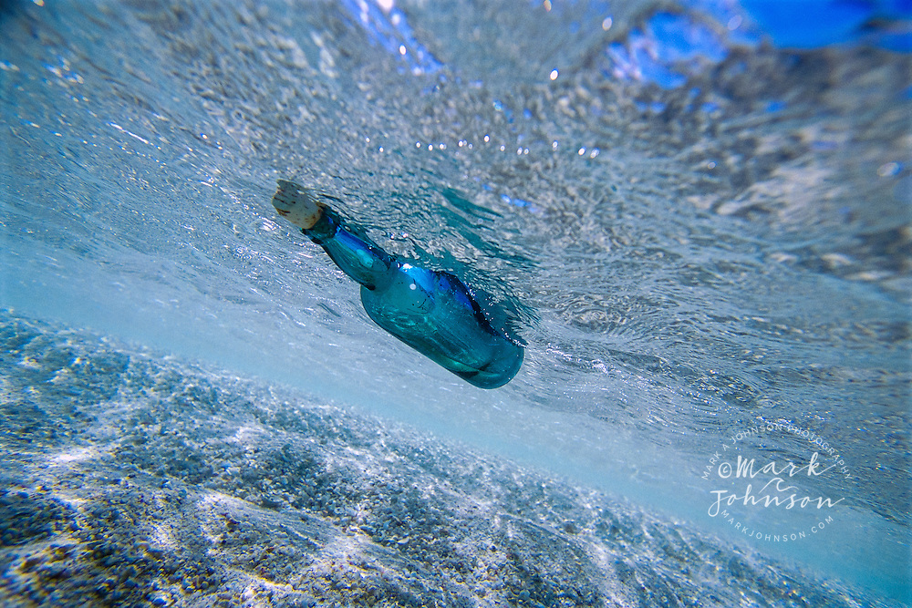 Message in a Bottle floating in the sea, Great Barrier Reef Marine Park, Australia