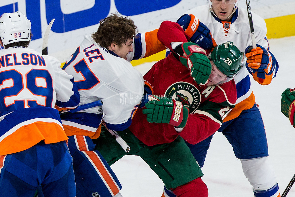 Dec 29, 2016; Saint Paul, MN, USA; New York Islanders forward Anders Lee (27) grabs Minnesota Wild defenseman Ryan Suter (20) during the third period at Xcel Energy Center. The Wild defeated the Islanders 6-4. Mandatory Credit: Brace Hemmelgarn-USA TODAY Sports