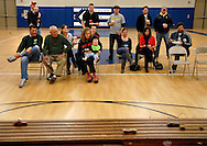 26 FEB. 2011 -- ST. LOUIS -- Racing fans watch intently as cars pass by on the track during the Adult Pinewood Derby sponsored by the Men's Club at Our Lady of Sorrows Catholic Church. Proceeds from the event, held at the church's parish hall in St. Louis Saturday, Feb. 26, 2011, benefitted the Boy Scouts of America. Image copyright © 2011 Sid Hastings.
