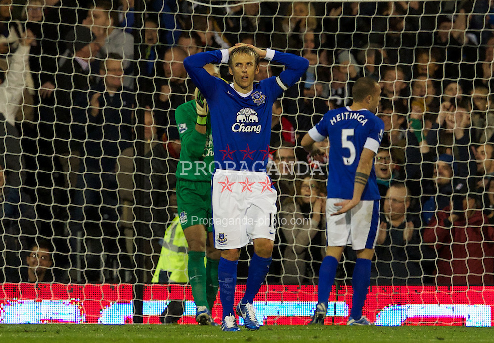 LONDON, ENGLAND - Saturday, November 3, 2012: Everton's captain Phil Neville looks dejected as he concedes a late equalising goal Fulham during the Premiership match at Craven Cottage. (Pic by David Rawcliffe/Propaganda)