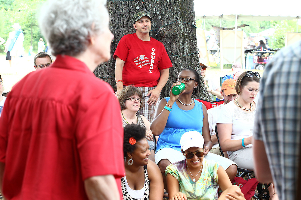Peterson Toscano, standing center, and other festival participants listen to Phyllis Tickle speak in a panel discussion on sexuality and justice at the Wild Goose Festival at Shakori Hills in North Carolina June 25, 2011.  (Photo by Courtney Perry)