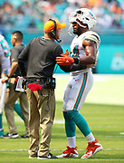 Sep 23, 2018; Miami Gardens, FL, USA; Miami Dolphins associate head coach Darren Rizzi gives instruction to Dolphins defensive end Robert Quinn (94) at Hard Rock Stadium against the Oakland Raiders. The Dolphins defeated the Raiders 28-20. (Steve Jacobson/Image of Sport)