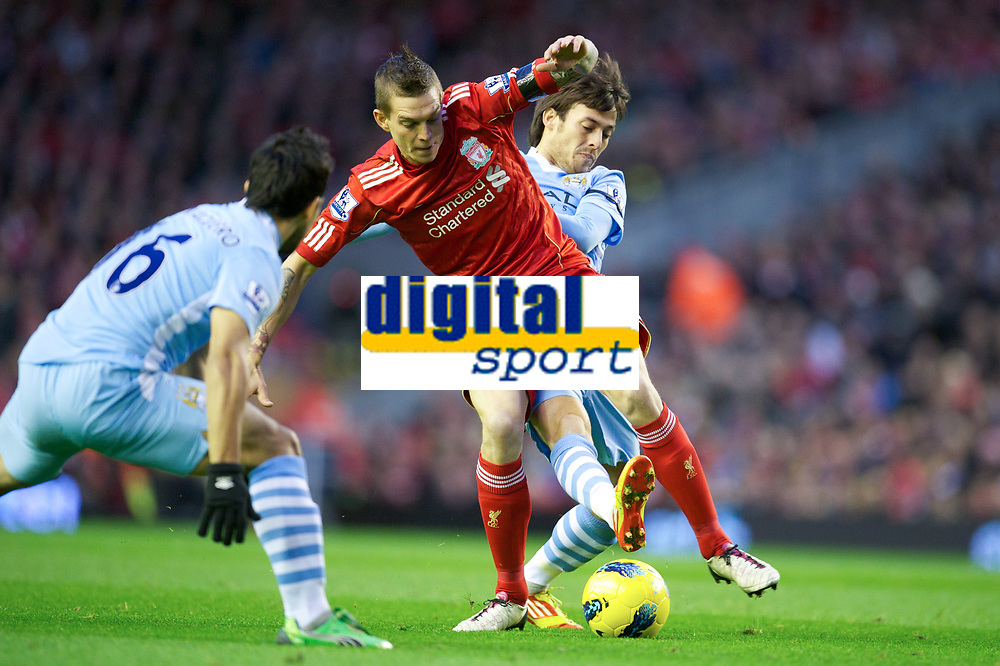 20111127: LIVERPOOL, ENGLAND - <br /> FC Liverpool vs Manchester City: English Premier League 2011/2012.<br /> In photo: Daniel Agger in action against Manchester City's David Silva.<br />  PHOTO: CITYFILES