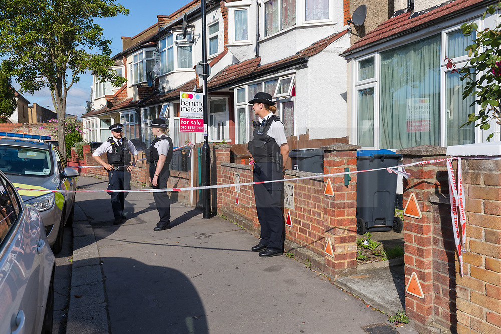 © Licensed to London News Pictures. 30/06/2019. Croydon, UK. Police at the scene in Raymead Avenue, Thornton Heath, Croydon where a women, aged 26 who was approximately eight months pregnant was was stabbed to death in the early hours of Saturday 29th June. The woman died at the scene and her baby is now critically ill in hospital. A 37-year-old man has been arrested on suspicion of murder and is in custody. Photo credit: Vickie Flores/LNP