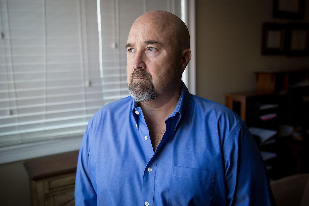 Cary Davidson, an interventionist, poses for a portrait in Cumming, Ga. on Tuesday, July 28, 2015. He and his wife, Heather Hayes, who is also an interventionist, are whistleblowers about corruption in their industry, including rehab centers and providers. This portrait was taken in Mrs. Hayes office building. Photo by Kevin Liles for The New York Times