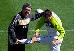 Physiotherapist Khalid Nasif and Andraz Kirm of Slovenia during a training session at  Hyde Park High School Stadium on June 14, 2010 in Johannesburg, South Africa.  (Photo by Vid Ponikvar / Sportida)