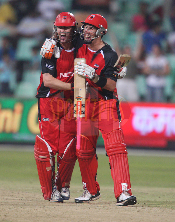 Cameron Borgas starts to celebrates victory over the Mumbai Indians with Tom Cooper during the match 7 of the Airtel CLT20 between The Mumbai Indians and The South Australian Redbacks held at Kingsmead Stadium in Durban on the 14 September 2010..Photo by: Steve Haag/SPORTZPICS/CLT20.