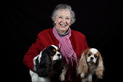 © Licensed to London News Pictures. 10/03/2016. Birmingham, UK. Paula Stark with her Cavalier King Charles Spaniels named Maudie and Amelia at Crufts 2016 held at the NEC in Birmingham, West Midlands, UK. The world's largest dog show, Crufts is this year celebrating it's 125th anniversary. The annual event is organised and hosted by the Kennel Club and has been running since 1891. Photo credit : Ian Hinchliffe/LNP