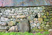 Stone barn with corrugated iron roof at Auchindrain highland farming township settlement and village folklore museum at Furnace near Inveraray in the Highlands of Scotland
