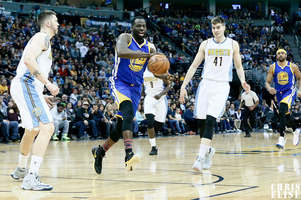 13 February 2017: Golden State Warriors forward Draymond Green (23) passes the ball past Denver Nuggets guard Mike Miller (3) and Denver Nuggets forward Juancho Hernangomez (41) during the Denver Nuggets 132-110 victory over the Golden State Warriors, at the Pepsi Center, Denver, Colorado, USA.