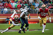San Francisco 49ers cornerback Dontae Johnson (36) tackles Seattle Seahawks wide receiver Paul Richardson (10) at Levi's Stadium in Santa Clara, Calif., on November 26, 2017. (Stan Olszewski/Special to S.F. Examiner)