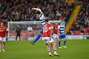Luke Amos of Queens Park Rangers and Mike-Steven Bahre of Barnsley FC compete for the ball during the EFL Sky Bet Championship match between Barnsley and Queens Park Rangers at Oakwell, Barnsley, England on 14 December 2019.