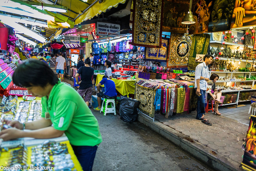 4 JUNE 2013 - BANGKOK, THAILAND:  Vendors in the Patpong Night Bazaar in Bangkok. Patpong was one of Bangkok's notorious red light districts but has been made over as a night market selling clothes, watches and Thai handicrafts. The old sex oriented businesses still exist but the area is now better known for its night shopping.      PHOTO BY JACK KURTZ