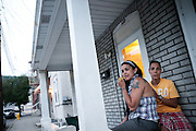 BETHLEHEM, PA – JUNE 28, 2011: Betsy and Wendy Santos of Bethlehem, Pennsylvania hang out at their stoop on June 28, 2011. As a lesbian couple, each share children from previous marriages and represent a growing number of same-sex Hispanic couples in the Lehigh Valley.<br />