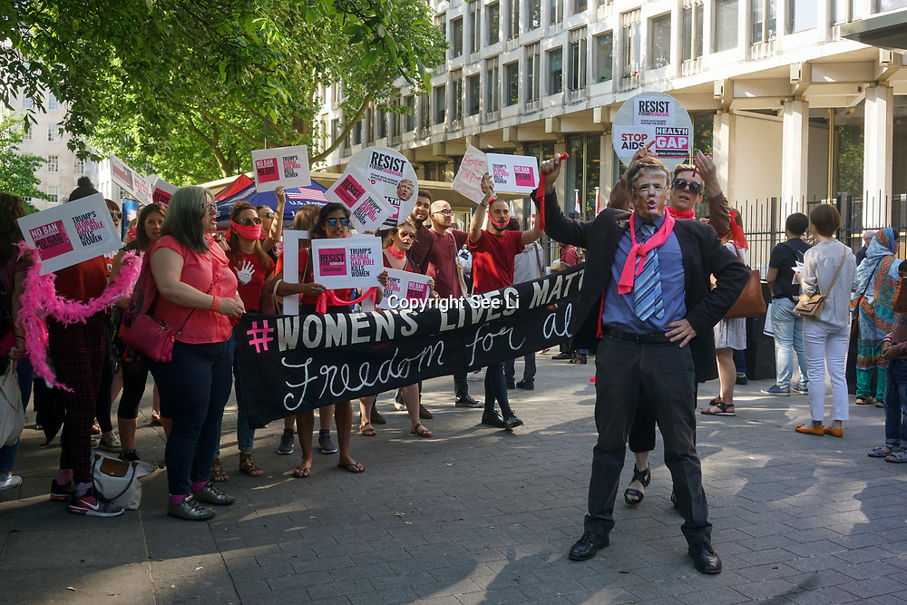 London,England,UK. 25th May 2017. protest coordinated with US groups protesting against Trump's Global Gag ruling which will cut all funding to orgs that give women information about abortion services at the US embassy. by See Li