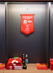 CARDIFF, WALES - Saturday, September 2, 2017: The dressing room booth of Wales' captain Ashley Williams along with the match pennant in the dressing room before the 2018 FIFA World Cup Qualifying Group D match between Wales and Austria at the Cardiff City Stadium. (Pic by David Rawcliffe/Propaganda)