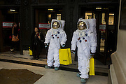 London 8/1/13: Two characters dressed as NASA moon walking astronauts, emerge outside on Oxford Street outside the Selfridges department store in central London - part of a PR promo for deodorant brand Lynx who have launched a competition, with the first prize a once-in-a-lifetime chance to blast into orbit. The 22 winners, which will include one Brit, will experience Earth from outer space on the Lynx SXC (Space Expedition Corporation) space shuttle. Shoppers and passers-by seem oblivious to this symbol of 20th century American technology, now reduced to a PR stunt for the Lynx aftershave brand hosted by Selfridges. Selfridges, also known as Selfridges & Co, is a chain of high end department stores in the United Kingdom. It was founded by Harry Gordon Selfridge. The flagship store in London's Oxford Street is the second largest shop in the UK (after Harrods) and opened 15 March 1909.