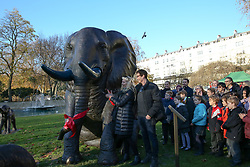 © Licensed to London News Pictures. 04/12/2019. London, UK. Artists GILLIE (L) and Marc (R) unveil a herd of 21 bronze elephants at Marble Arch. The sculpture is the largest such depictionof an elephant herd in the world and is intended to draw attention to the plight of this species that could be extinct on current trends, by 2040. Each elephant in the sculpture is modelled after a real orphaned animal currently in the care of the Sheldrick Wildlife Trust. Left behind by poachers and other sources of human-wildlife conflict these animals have been raised by the trust in an effort to secure the future of the species. The herd will be displayed until 4 December 2020. Photo credit: Dinendra Haria/LNP