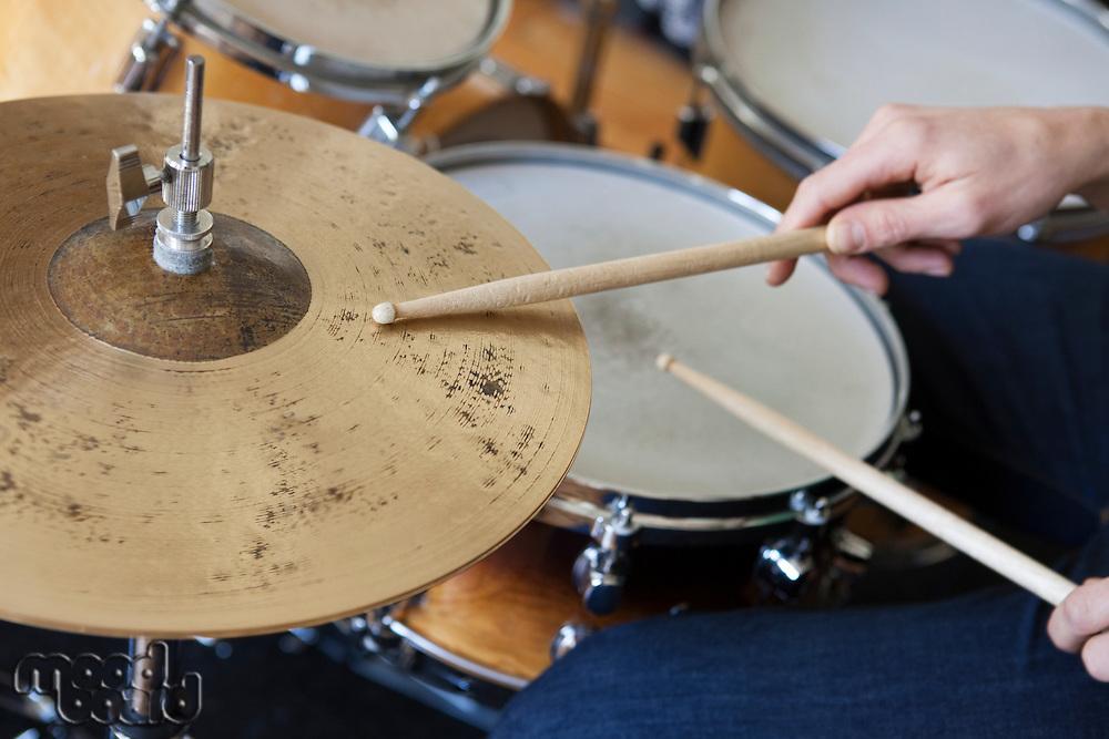 Caucasian man plays drum set