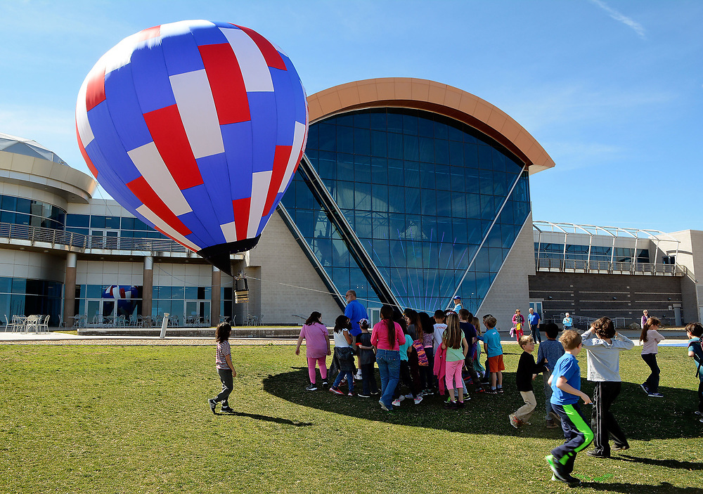 jt031417c/spec sec /jim thompson/Students  from Colinas del Norte Elm. School in Rio Rancho try to stay in the shadow of the remote controlled hot air balloon at the Anderson Abruzzo Albuquerque International Balloon Museum. Tuesday March. 11, 2017. (Jim Thompson/Albuquerque Journal)