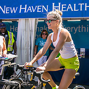 August 23, 2016, New Haven, Connecticut: <br /> Eugenie Bouchard of Canada rides a spin bike at the the Yale New Haven Health booth during Day 5 of the 2016 Connecticut Open at the Yale University Tennis Center on Tuesday, August  23, 2016 in New Haven, Connecticut. <br /> (Photo by Billie Weiss/Connecticut Open)