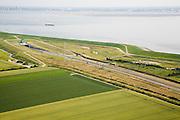Nederland, Zeeland, Zuid-Beveland, 04-07-2006; luchtfoto : Noordelijke ingang Westerscheldetunnel, direkt ten Westen van het dorpje Ellewoutsdijk, aan de horizon Zeeuws-Vlaanderen (Zeeuwsch-Vlaanderen);toltunnel, tol, planologie, verkeer en vervoer, tol, privaat publieke samenwerking, PPS, mobiliteit, auto, infrastructuur, milieu; zie ook andere (lucht)foto's van deze lokatie, deevan de serie Panorama Nederland; luchtfoto (toeslag); aerial photo (additional fee required); .foto Siebe Swart / photo Siebe Swart