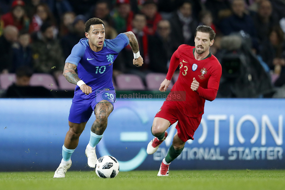 (L-R) Memphis Depay of Holland, Adrien Silva of Portugal, during the International friendly match match between Portugal and The Netherlands at Stade de Genève on March 26, 2018 in Geneva, Switzerland