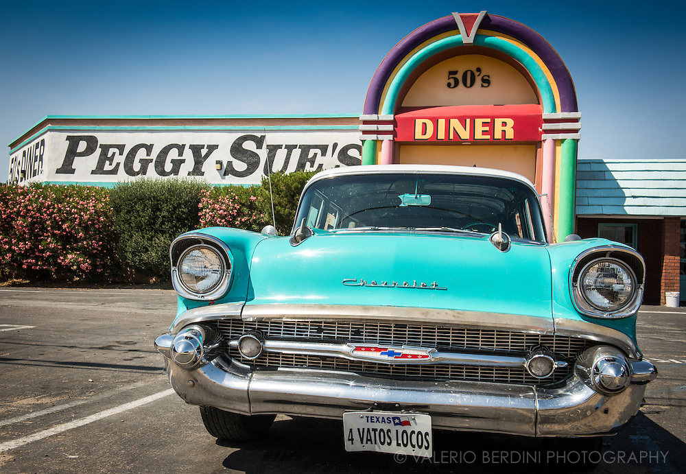 Chevrolet parked at Peggy Sue's 50's Diner. Peggy Sue's is an original roadside Diner, built in 1954 with 9 counter stools and 3 booths. It sets in on the shadow of the Calico Mountains and was built from railroad ties and mortar from the nearby Union Pacific Rail yard.