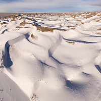 USA, Colorado, Great Sand Dunes National Park, Aerial view of snow-covered sand dunes on winter morning