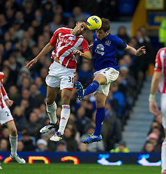 04122011, Goodison Park, Liverpool, ENG, Premier League, FC Everton vs Stoke City, 14 Spieltag, im Bild Everton's Diniyar Bilyaletdinov in action against Stoke City's Ryan Shotton during the football match of english Premier League, 14th round between FC Everton and Stoke City at Goodison Park, Liverpool, ENG on 2011/12/04. EXPA Pictures © 2011, PhotoCredit: EXPA/ Sportida/ David Rawcliff..***** ATTENTION - OUT OF ENG, GBR, UK *****