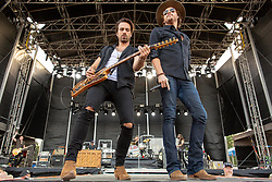 June 20, 2018 - Oshkosh, Wisconsin, U.S - ZACH BROWN and MICHAEL HOBBY of A Thousand Horses during Country USA Music Festival at Ford Festival Park in Oshkosh, Wisconsin (Credit Image: © Daniel DeSlover via ZUMA Wire)