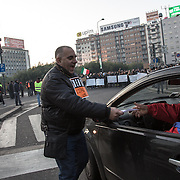 12 December, Milan: a man of the new movement of citizens protesting against the governement, distribute flyers during a roadblock