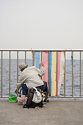 elderly person fishing at the sea coast Japan near Tokyo