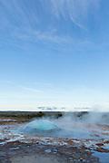 Strokkur geyser erupting during a fine summer's evening in southern Iceland.