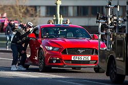 © Licensed to London News Pictures. 11/02/2016. London, UK.  Former Top-Gear presenter RICHARD HAMMOND poses for a selfie with a fan while filming in new red 2016 Ford Mustang GT Coupe sports car on Westminster Bridge in central London. Hammond is currently preparing to take part in a new Amazon Prime television series with former Top-Gear co-hosts Jeremy Clarkson and James May. Photo credit: Ben Cawthra/LNP