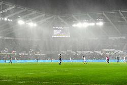 The game kicks off in the downpour - Mandatory by-line: Craig Thomas/JMP - 02/01/2018 - FOOTBALL - Liberty Stadium - Swansea, England - Swansea City v Tottenham Hotspur - Premier League