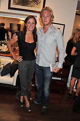 NATALIE PINKHAM and OWAIN WALBYOFF at a party to celebrate the launch of the new Mauritius Collection of jewellery by Forbes Mavros held at Patrick Mavros, 104-106 Fulham Road, London SW3 on 5th July 2011.