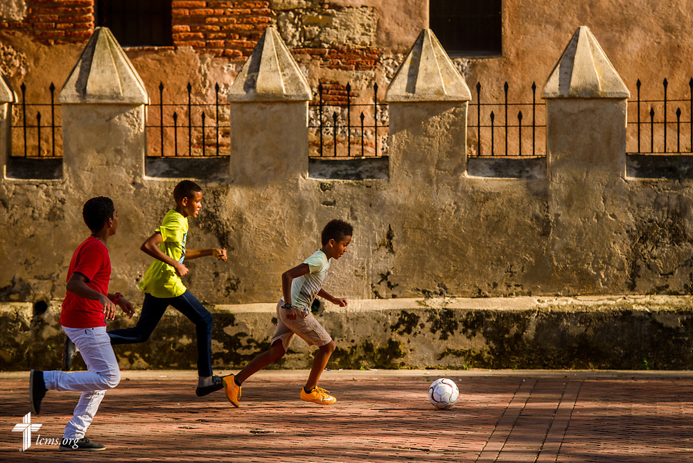 Children play soccer in the colonial zone of Santo Domingo, Dominican Republic, on Sunday, March 19, 2017. LCMS Communications/Erik M. Lunsford
