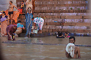 Hindu people bathing at Ganges river in Varanasi in India.