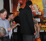 Picture by Ramsey Cardy/Focus Images Ltd +44 7809 235323.08/02/2013.Carl Frampton and Kiko Martinez are separated by Matchroom Boxing promoter Eddie Hearn at the weighs in for his  EBU Super-Bantamweight Title fight against Kiko Martinez in Odyssey Arena, Belfast..