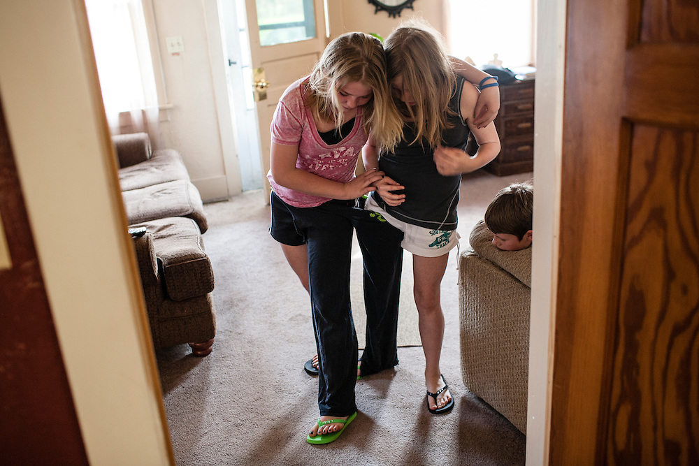 Libby Johnson and Alanna McFarland walk around their house wearing a single pair of pants on Sunday, March 25, 2012 in Webster City, IA.