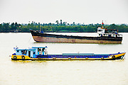 "11 MARCH 2006 - MY THO, VIETNAM: Commercial ship traffic on the Mekong River near My Tho, capitol of Tien Giang province in Vietnam on the Mekong River. My Tho is the closest port to Ho Chi Minh City. The Mekong and its delta is the economic lifeblood of southern Vietnam. The river carries a tremendous amount of commercial shipping and passenger traffic and the rice paddies in the delta have become the ""rice bowl"" of Vietnam. Vietnam is now the second leading exporter of rice in the world, after Thailand. PHOTO BY JACK KURTZ"